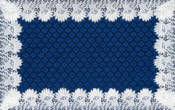 White lace on background blue guipure Royalty Free Stock Photography