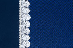 White lace on background blue guipure Royalty Free Stock Images