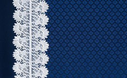 White lace on background blue guipure Stock Image