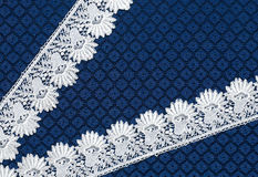 White lace on background blue guipure Royalty Free Stock Photo