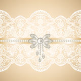 White lace on beige background Royalty Free Stock Photography