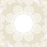 White lace on beige background Stock Image