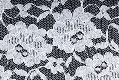 White lace on black. White lace on a black background Royalty Free Stock Photo