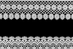 White lace on the black  background. White  lace  on  the  black   background Royalty Free Stock Image