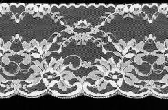 White lace on a black background. Royalty Free Stock Images