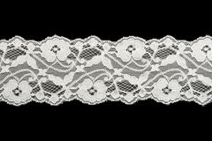 White lace on black background Royalty Free Stock Images