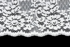 White lace on a black background Stock Photography