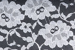 White lace on black background. White lace on a black background Stock Photography
