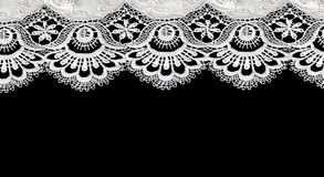 White lace on black background Stock Photography