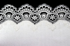 White lace on black background Royalty Free Stock Photo