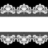 White lace on black background Royalty Free Stock Photos