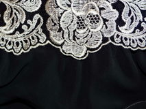 White lace with black cloth Stock Photo