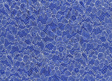 Fabric (white lace on blue fabric) Royalty Free Stock Image