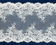 White lace on a blue. Stock Photography
