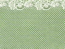 White lace border on green background. White VINTAGE lace border on green background stock image