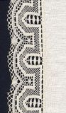 White lace border and material. The lace border of an handcrafted tablecloth stock images