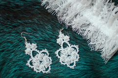 White lace bridal accessories on the fur blue background. Weddin Stock Images