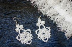 White lace bridal accessories on the fur blue background. Weddin Royalty Free Stock Image