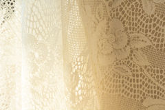 White lace cotton background. Light on white lace cotton background royalty free stock photos