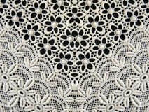 White lace fabric. On black background Stock Photo
