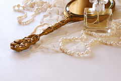 White lace fabric, perfume, mirror and white flowers Royalty Free Stock Photos