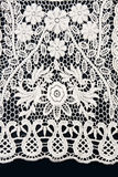 White lace with a floral pattern Stock Photo