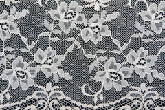 White lace with a floral pattern Stock Image