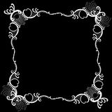 Lacy frame Blackboard Background. White lace frame with black background. Message can be written in white Stock Image