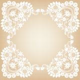 White Lace Frame. Elegant white lace frame on a beige background Stock Image