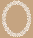 White lace frame. Oval white lace frame with shadow on a beige background Royalty Free Stock Photos
