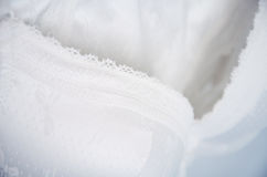 White lace lingerie hanging on the hanger close up, horizontal. Stock Photo