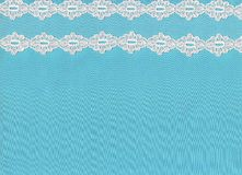 White Lace On Blue Background. Stock Photography