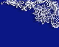 White lace ornament on blue background. Royalty Free Stock Images