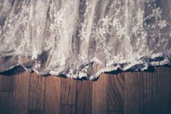 White lace on parquet Royalty Free Stock Images