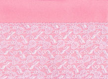 White lace on pink background. White lace border on pink background Royalty Free Stock Photography