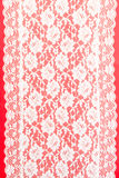 White lace on red. White lace with a red background Stock Photo