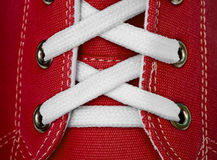 White lace on red sneakers Royalty Free Stock Images