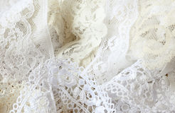 White lace ribbon. A variety of white lace ribbon Stock Image