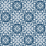 White lace seamless pattern with flowers on blue Royalty Free Stock Photos