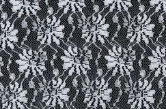 White lace seamless pattern with flowers on black background Stock Images