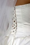 White lace and silk. The back of a bride's wedding dress, with lace and ribbons Stock Photos