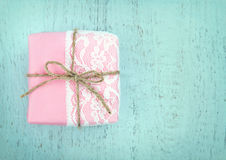 White lace and a simple bow on pink gift box Royalty Free Stock Photo