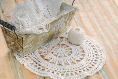 White lace in vintage basket Stock Photos