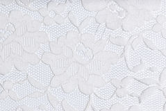 White lace on white. White lace on a white background Royalty Free Stock Image