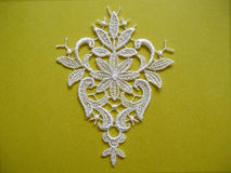 White lace on yellow Royalty Free Stock Images