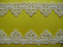 White lace on yellow Royalty Free Stock Photos