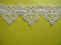 White lace on yellow Stock Image