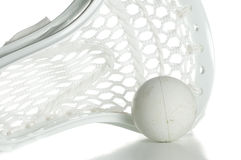 White Lacrosse Head with Ball Stock Images