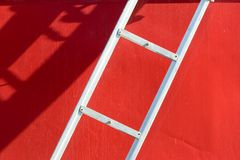 White ladder on red boat Royalty Free Stock Images