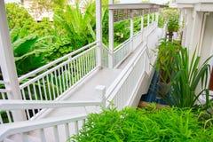 White ladder walking path surround with garden tree Royalty Free Stock Photos